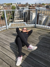 Soaking up the sun on a rooftop in Amsterdam